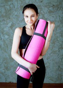 Teenage girl with eating disorder and yoga mat